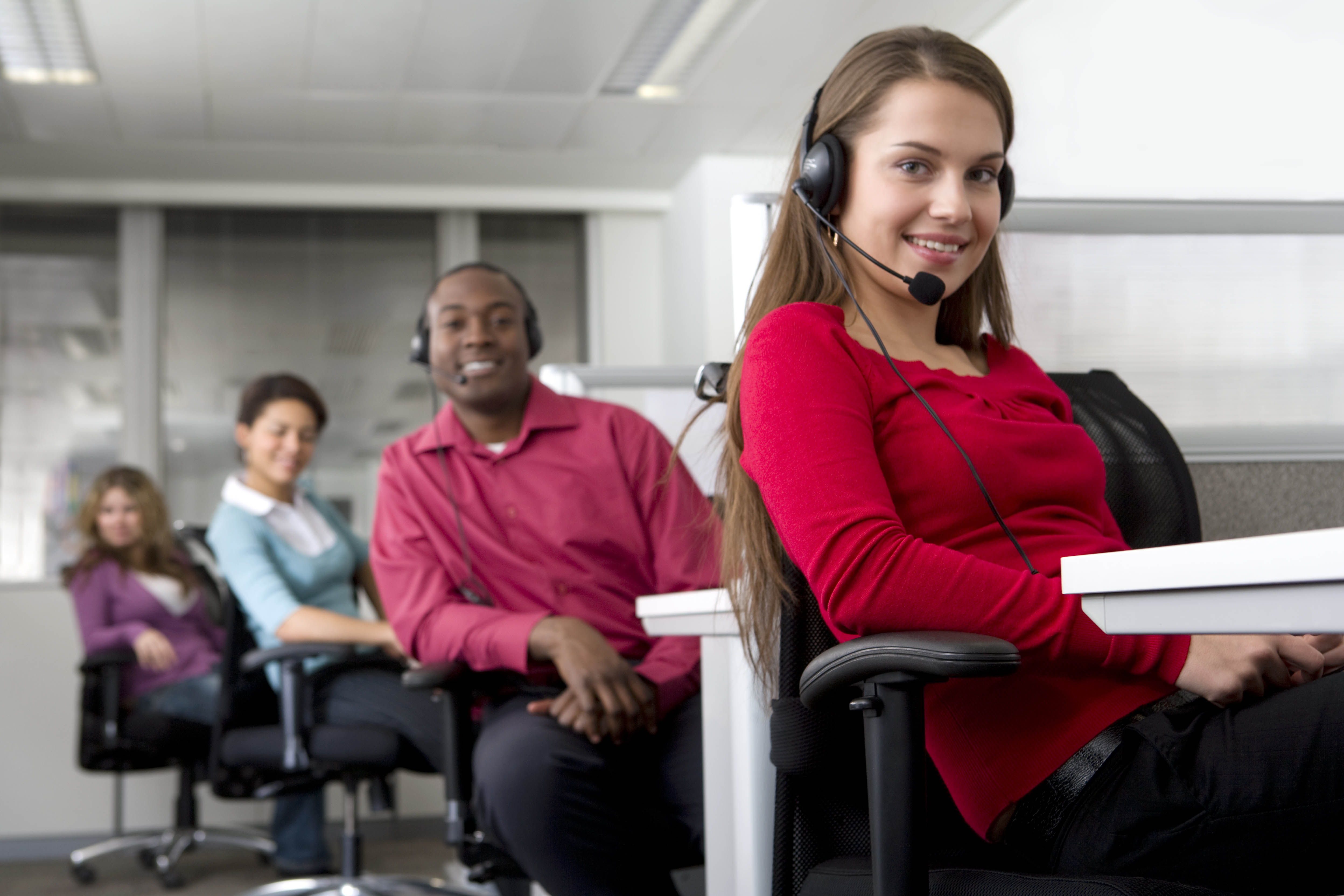 Businesswoman and co-workers working in cubicles